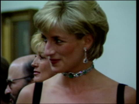 Princess Diana shown dying on Family reaction LIB London Tate INT Diana Princess of Wales in black sparkly dress at the Tate talking to others