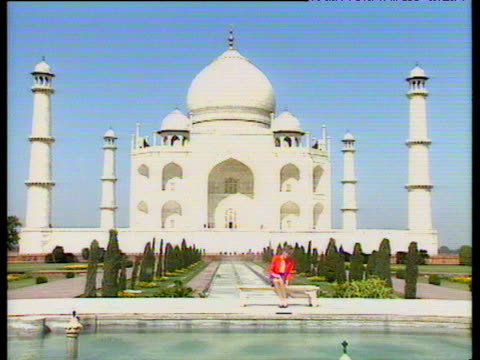 Princess Diana sits on bench posing for photographers in front of Taj Mahal during official visit India 11 Feb 92
