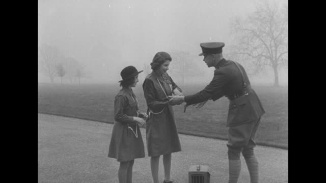 VS Princess Elizabeth and Prince Philip walk in a wooded area with a corgi / seated at a bench / VS the couple looks over documents // February 20 VS...
