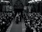 Princess Elizabeth and the Duke of Edinburgh walk down the aisle of Westminster Abbey accompanied by her bridesmaids and page boys and the best man...