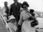 Princess Grace of Monaco leaves a plane at London Airport with her children Caroline and Albert 1961
