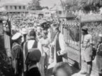 Princess Margaret arrives at the cathedral church of St Jayo de la Vega and is greeted by Dr Montagu Dale the Bishop of Jamaica