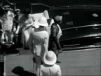 Princess Margaret on tour of East Africa ZANZIBAR EXT Guards fire cannons from quayside as royal yacht Britannia arrives / Crowds of people in...