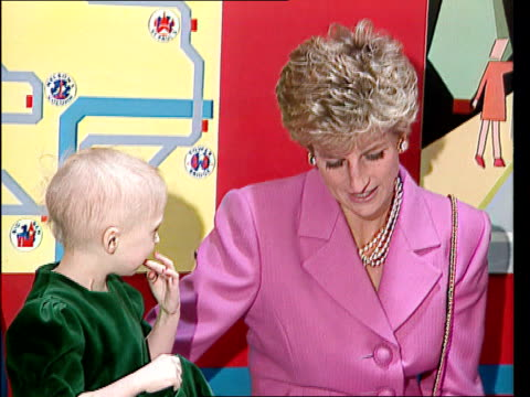 Princess of Wales memorial fund LIB Princess talking with child during visit to hospital LIB Osteopathic Centre for Children Children on and around...