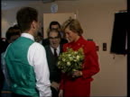 Princess of Wales opens AIDs centre ENGLAND London St Stephen's Hospital CMS Princess of Wales wearing crimson suit with brass buttons accompanied by...