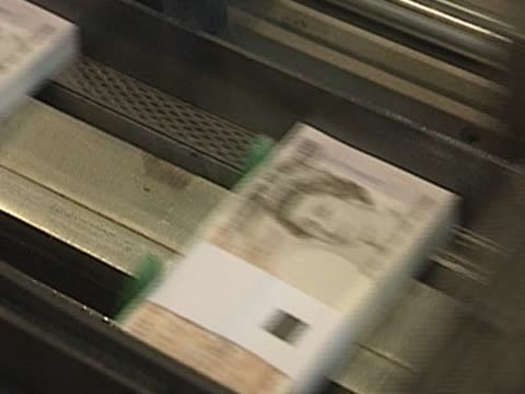 A printing press sorts British ten pounds notes UK
