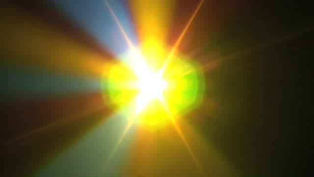 Prism Rainbow Light beams Spinning through smoke, HD video