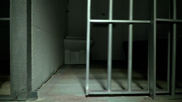 4K: Prison / Jail Cell door closing shut