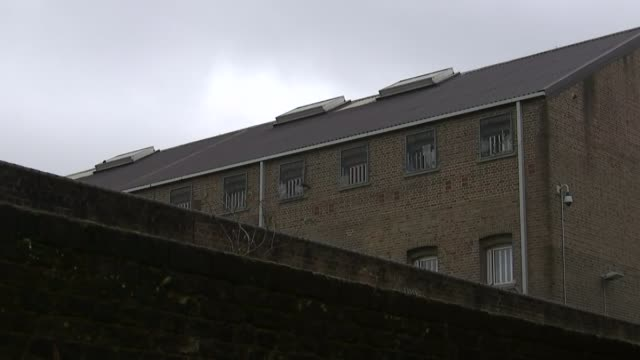 Prison officers protest over worsening conditions London Pentonville Prison View of prison over wall Prisoner seen through grate as speaks to ITN SOT...
