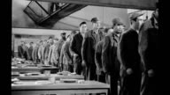 1939, Prisoners filing into prison dining hall