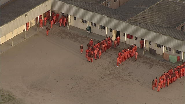 AERIAL ZO Prisoners in yard with guards at Pollsmor Prison, Cape Town, Western Cape, South Africa