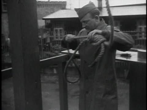 prisoners walking / man preparing noose / soldiers preparing prisoner