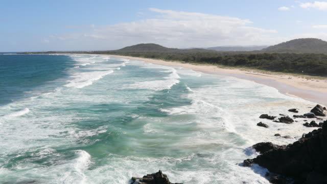 Orörda ren strand på Cabarita, NSW, Australien