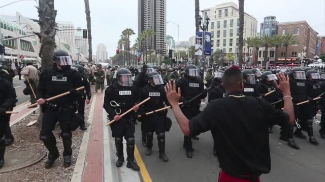 Pro and anti Donald Trump demonstrators face off outside a rally for the presumptive Republican presidential nominee in San Diego