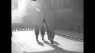 GV procession of Nazi Party dignitaries march down path between large number of soldiers standing in formation in Konigsplatz during Beer Hall Putsch...
