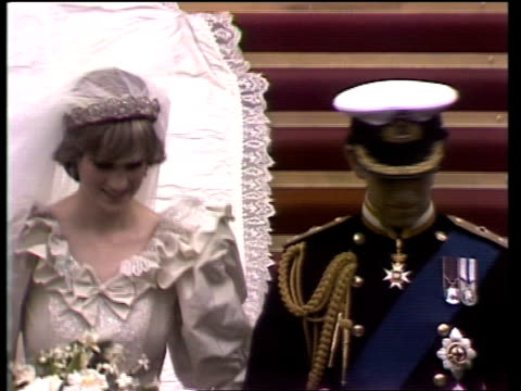 Procession ROYAL WEDDING Procession GV Couple at door CTS Towards GV Periscopes CMS Towards Charles says to her 'Wave now' CS/SIDE Couple MS Down...