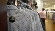 Products are displayed for sale inside a Myer Holdings Ltd department store in Melbourne Australia on Friday March 13 Men's shirts are displayed on...