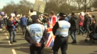 London EXT Various of proEU marchers gathering marching along Whitehall / armed police outside Downing Street / mounted police along / AntiBrexit...