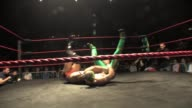 A professional American style wrestling match sequence from a 3 way match featuring a masked Mexican Luchador