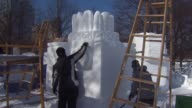 WGN 15 professional and 12 high school teams participated in the 6th Annual Snow Days sculpting competition at Navy Pier on February 06 2014 in...