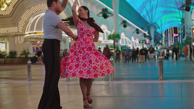 SLO MO. Professional ballroom dancers swing and dance in Downtown Las Vegas.