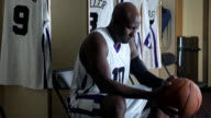 CU PAN professional basketball player in locker room holding basketball / Washington, USA