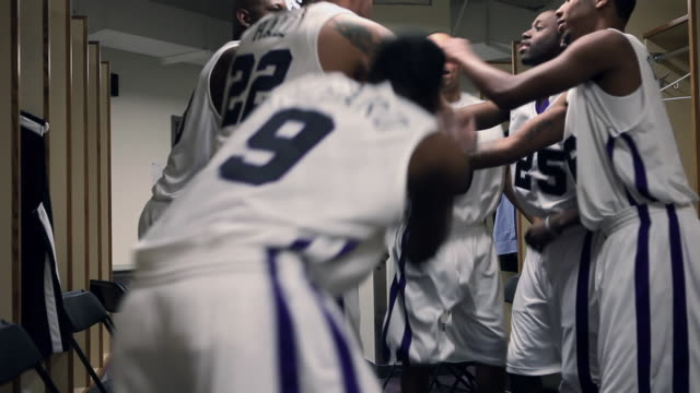 MS professional basketball team and coach in locker room running out to game / Washington, USA