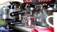 Professional coffee machine making espresso