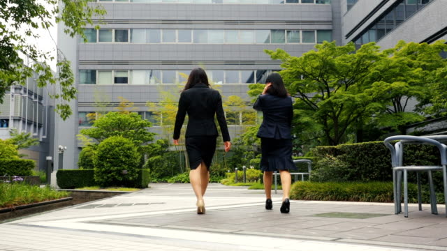 Professional Corporate Japanese Business Women Walking in an Office Courtyard