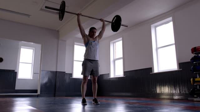 Professional Female Powerlifter Doing Overhead Press