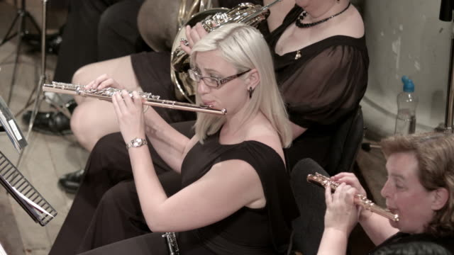 Professional flautist plays in orchestra