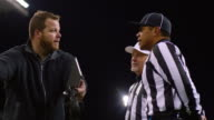 MS LA DS SLO MO Professional football coach arguing with referees during game