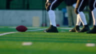 MS LA SLO MO Professional football offensive line snapping football and protecting quarterback