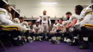 MS DS LA Professional football player motivating teammates in locker room before game