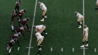 MS Professional football running back taking hand off and running through line of scrimmage