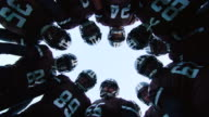 MS LA POV SLO MO Professional football team coming in to huddle