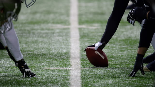 CU Professional football team coming to line of scrimmage and snapping ball during game