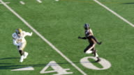 MS TS Professional football wide receiver running down sideline covered by defensive back and missing pass