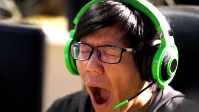 CU Professional Gamer Yawning while Playing Computer Game