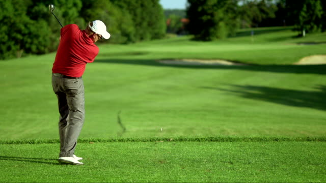 SLO MO LS Professional Golfer Teeing Off