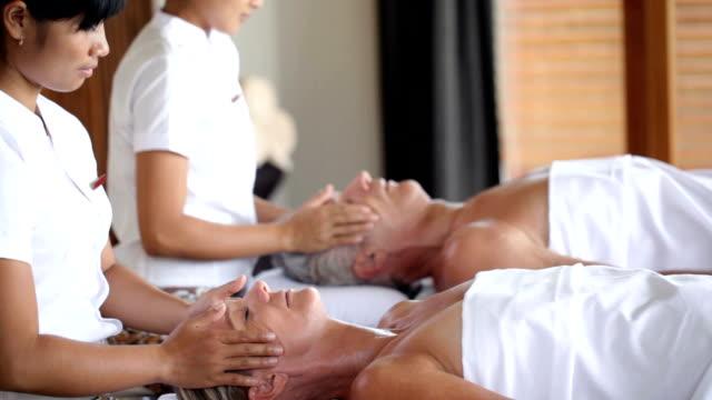 Professional Thai masseurs at work