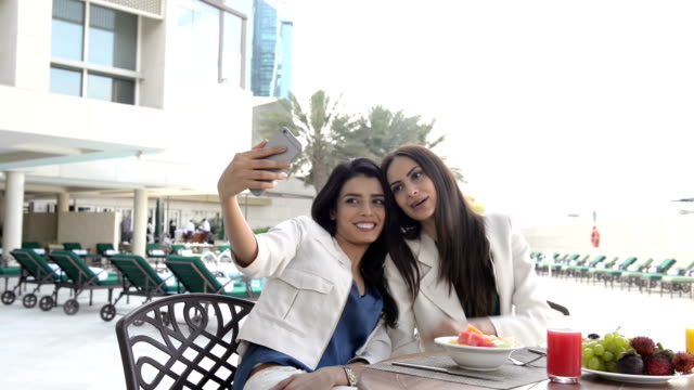 Professional young women taking a selfie