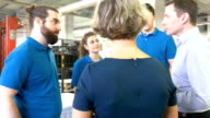 Professionals discussing at printing plant