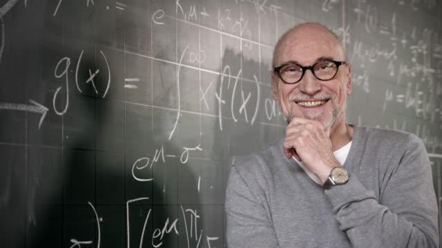 Professor smiling in camera