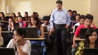 Professor taking a class in a college