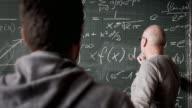 Professor talking to student