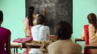 Professor teaching university students in the classroom, Haryana, India