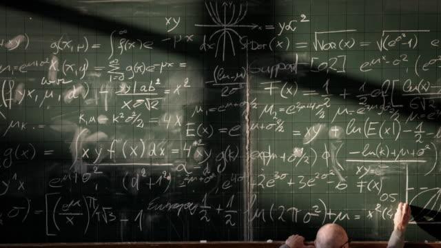 Professor writing on blackboard (timelapse)