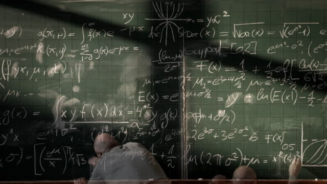 Professor writing on blackboard (timelapse)