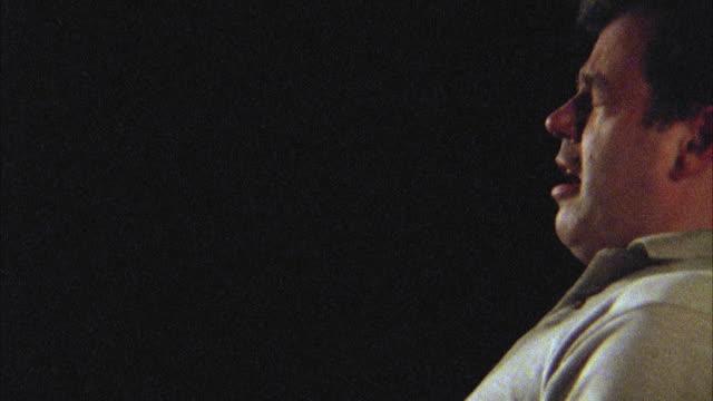 SLO MO, CU, Profile of man sneezing